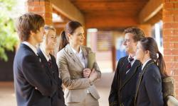 iStock high school teacher talking to students 000022220802 Large